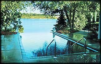 Inground Rectangle Vanishing Edge Custom Concrete Pool, Pebble Tec. Fox River, De Pere, Wisconsin