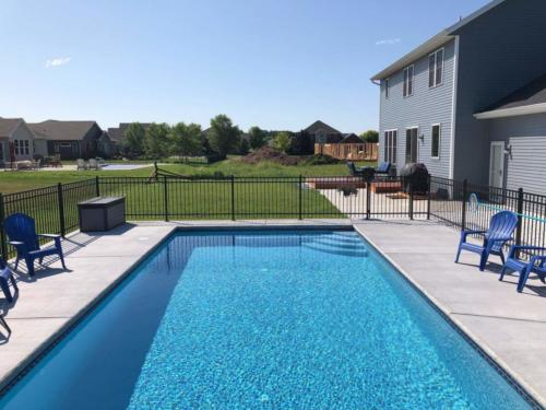 Inground Rectangle Custom Concrete Pool 15x30, Glass Tile: Bella Blue, Pebble: Fina. Oshkosh, Wisconsin