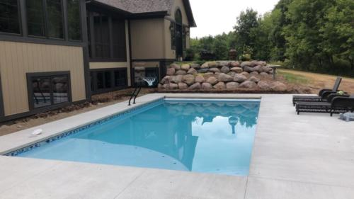 Inground Rectangle Custom Concrete Pool 15x30, with SunDeck Auto-Cover and Basketball Hoop, Glass Tile: Bella Blue, Pebble: Fina. Green Bay, Wisconsin
