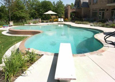 Inground Freeform Vanishing Edge Custom Concrete Pool 16x18x52, with Diving Board, Pebble Sheen. De Pere, Wisconsin