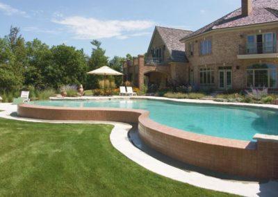 Inground Freeform Vanishing Edge Custom Concrete Pool 16x18x52, Pebble Sheen. De Pere, Wisconsin