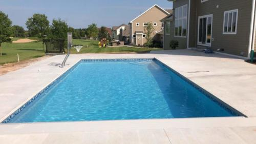 Inground Rectangle Custom Concrete Pool 16x32, with Auto Cover and Basketball Hoop, Bella Blue Pebble Fina, Glass Tile. Oneida, Wisconsin