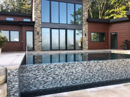 Pools-IngroundConcretePools-Custom-18x30-Rectangle-Vanishing-Edge-Midas-Tile-OceanBlue-Pebble-Sheen-DePere-Wisconsin