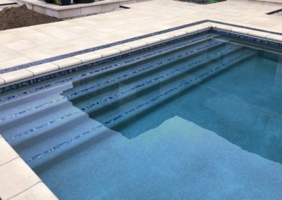 Inground Rectangle Custom Concrete Pool 18x36, with Auto Cover, Tile: Blue Granite Pebble Sheen Luminous. Harrison, Wisconsin