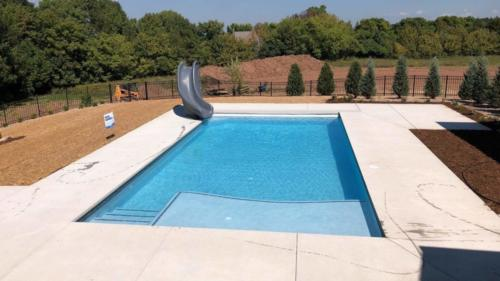 Pools-IngroundConcretePools-Custom-18x36-Rectangle-SunDeck-Slide-BellaBlue-Pebble-Fina-CTGLV7715-Glass-Tile-AutoCover-DePere-Wisconsin