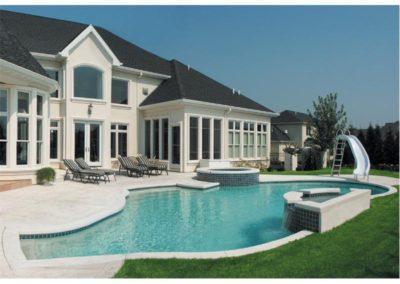 Pools-IngroundConcretePools-Custom-18x38-Freeform-Pebble-Sheen-Slide-Waterfall-Spa-Combo-Appleton-Wisconsin