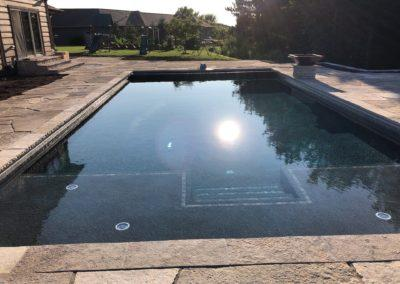 Pools-IngroundConcretePools-Custom-20x40-Rectangle-Auto-Cover-OceanBlue-Pebble-Sheen-SunDeck-Bubblers-3622-Maya-Fire-Water-Bowls-Suamic-Wisconsin