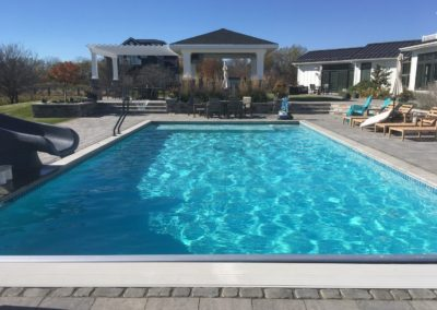 Pools-IngroundConcretePools-Custom-20x40-Rectangle-Auto-Cover-TurboTwist-Slide-Basketball-Acquios-Pebble-Fina-Manitowoc-Wisconsin