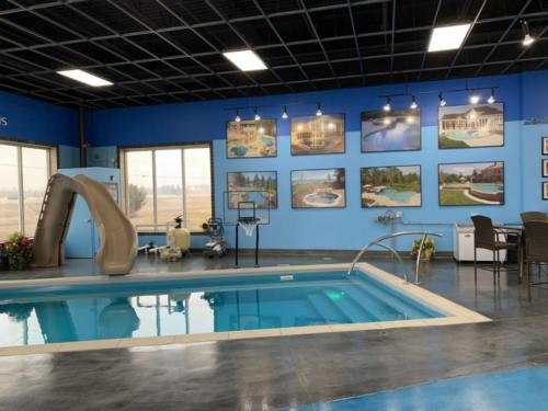 Pools-IngroundFiberglassPools-13x27-LilBob-Rectangle-Showroom-Auto-Cover-Slide-BasketBall-DePere-Wisconsin